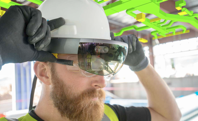 Image of a man putting on augmented reality goggles