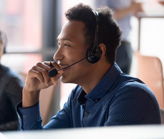 broker on headset speaking to shipper