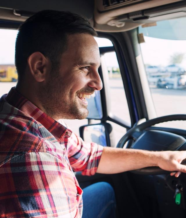 Smiling truck driver in cab