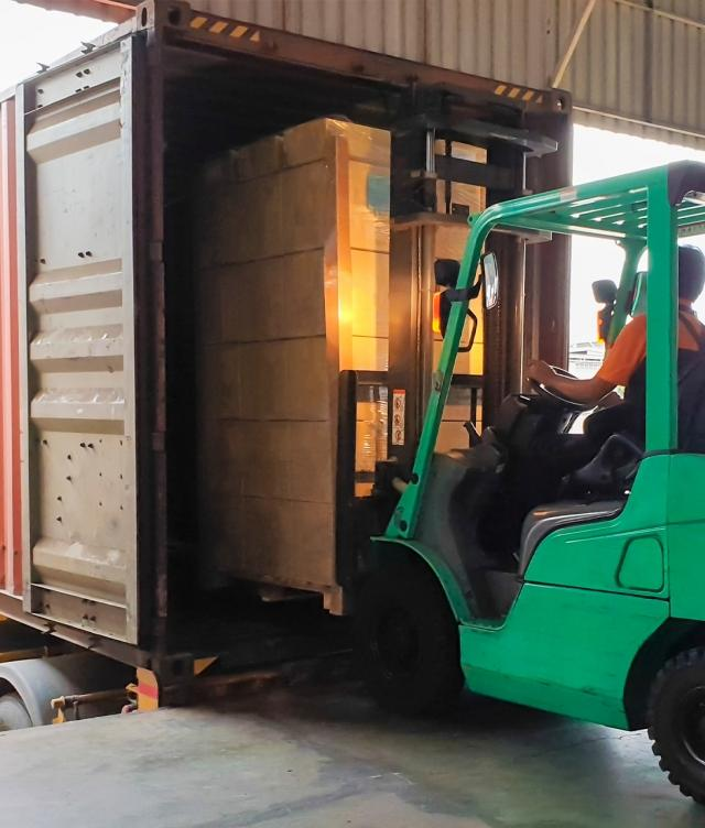 forklift loading freight into truck