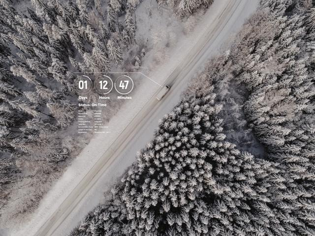 Tracking of freight on snowy road - aerial view