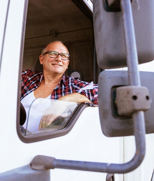 truck driver smiling out of window